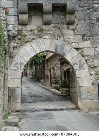 Medieval gate  in city walls of  Rocamadour, France
