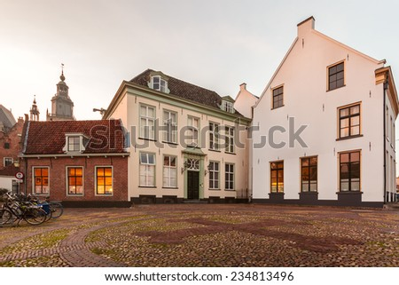 Medieval houses in the Dutch city of Zutphen during sundown - stock photo