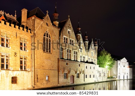 Medieval houses on canal in Bruges at night, Belgium