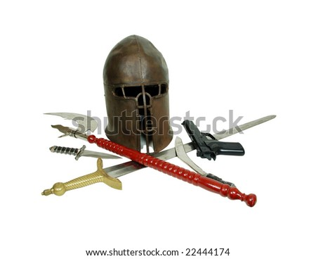 Medieval items and period armor displaying power, and a black hand gun used for target practice Outdated and antique equipment