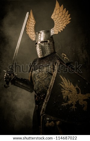 Medieval knigh with a sword - stock photo