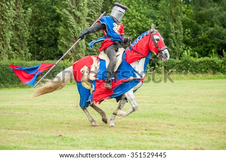Medieval knight costume on a horse and man with flag & Medieval Knight Costume On Horse Man Stock Photo (Royalty Free ...