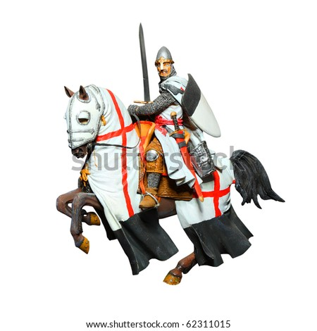 Medieval knight - crusader with a sword on a battle horse. Unauthorized homemade work (plaster figure - scratchbuild). - stock photo