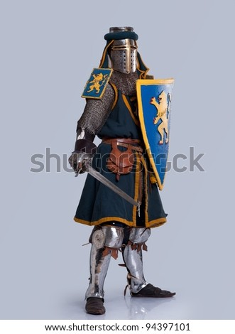 Medieval knight isolated on grey background. - stock photo