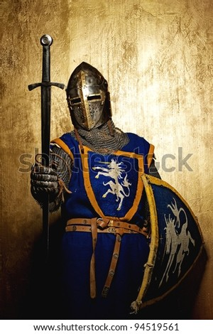 Medieval knight on golden background. - stock photo