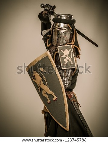 Medieval knight with sword and shield - stock photo