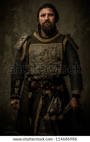 Medieval knight without weapon - stock photo