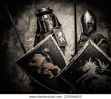 Medieval knights against stone wall - stock photo