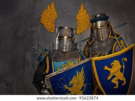 Medieval knights on grey background. - stock photo
