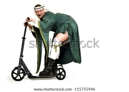 medieval lady with modern scooter - stock photo