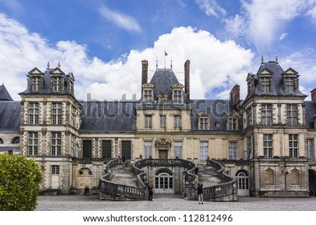 Medieval landmark - royal hunting castle Fontainbleau. Palace of Fontainebleau - one of largest royal chateaux in France (55 km from Paris), UNESCO World Heritage Site. - stock photo