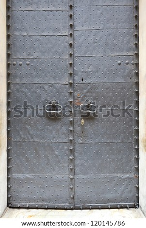 medieval metal door in the Genoa, Italy