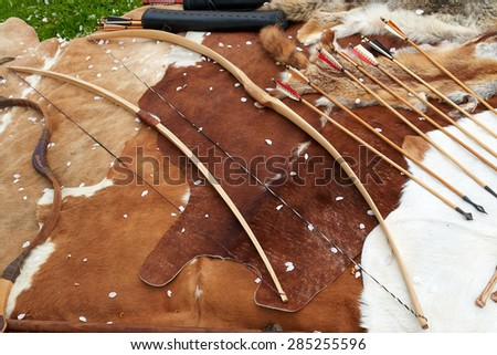 Medieval Middle Age weapons traditional bows and arrows in a display                               - stock photo