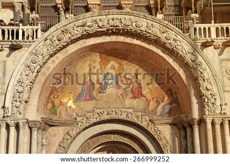 Medieval mosaic fresco on famous Patriarchal Cathedral Basilica  facade on San Marco Square in Venice (Venezia), Italy - stock photo