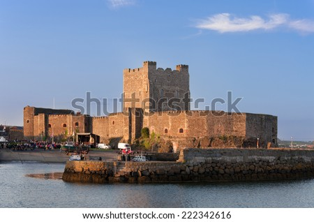 Medieval Norman Castle in Carrickfergus, Northern Ireland, in sunset light - stock photo
