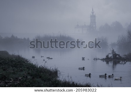 Medieval river city of Ponte de Lima, north of Portugal, in a foggy twilight - stock photo