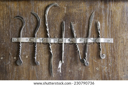 Medieval scalpels, detail of antique medical tools - stock photo