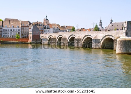 Medieval St. Servatius bridge over the river Meuse. Built from 1280 - 1298, Maastricht, The Netherlands - stock photo