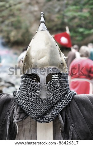 Medieval Templar helmet waiting for its knight - stock photo