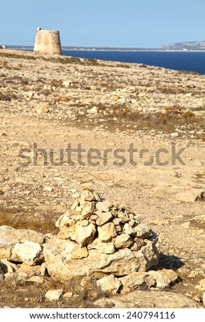 Medieval tower at Road to Barbaria lighthouse Formentera island Balearic islands Spain - stock photo