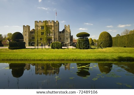 Medieval tower of a Tudor Hever Castle in England, mirroring in water on a beautiful day - stock photo