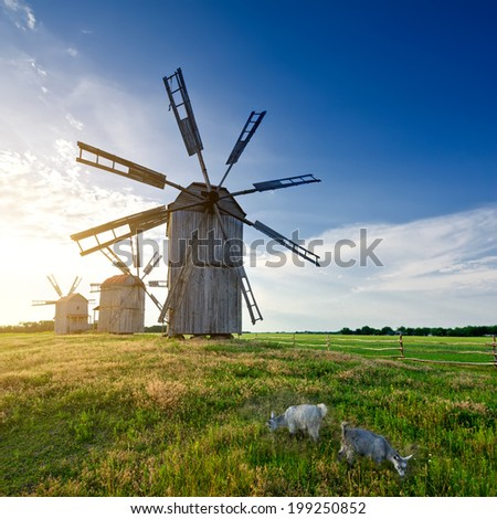 Medieval tower windmill on the countryside. landscape - stock photo