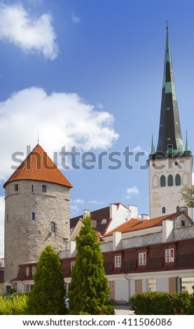 Medieval towers - part of the city wall and St Olaf (Oleviste) Church. Tallinn, Estonia - stock photo