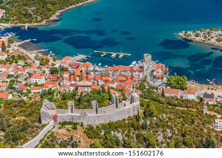 Medieval town Mali Ston in Dubrovnik area at the one end of the world known Ston walls. Second in world the longest defense wall with fortress Koruna. - stock photo