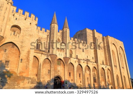Medieval walls with Gothic architecture of the Papal Palace (Palais des Papes) in Avignon, Provence, France - stock photo