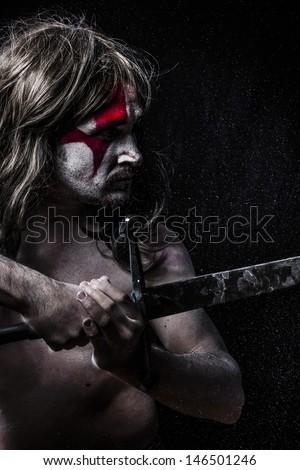 Medieval warrior fighting, medieval soldier with huge steel sword, naked - stock photo
