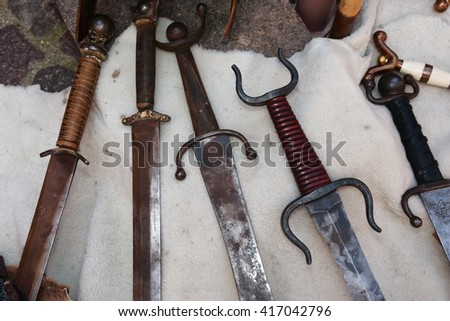 medieval weapons swords and knives - stock photo