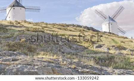 Medieval windmill on a hill overlooking the town of Consuegra in Toledo province, Spain. They dating from the 16th century . - stock photo