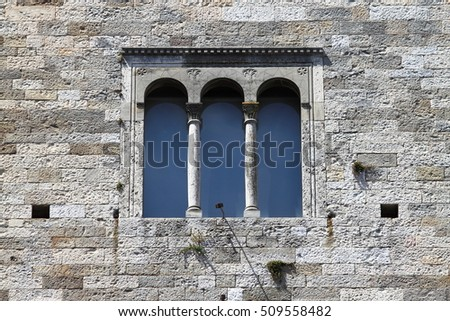 Medieval window in Todi. Umbria, Italy