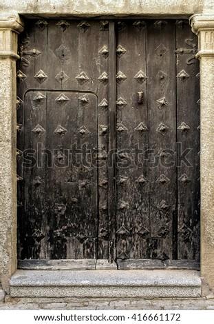 Medieval wooden gate in Toledo, Spain - stock photo