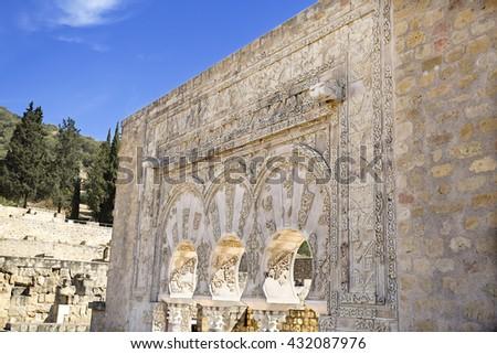 MEDINA AZAHARA, SPAIN - September  11, 2015: Detail of the facade of the House of Yafar at Medina Azahara medieval palace-city near Cordoba, on September  11, 2015 in Medina Azahara, Spain - stock photo