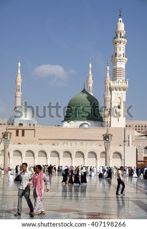 MEDINA, KINGDOM OF SAUDI ARABIA (KSA) - JAN 30: Pilgrims pray outside Masjid Nabawi after morning prayer Jan 30, 2015 in Medina, KSA. Underneath the green dome where Prophet Muhammad is laid to rest. - stock photo