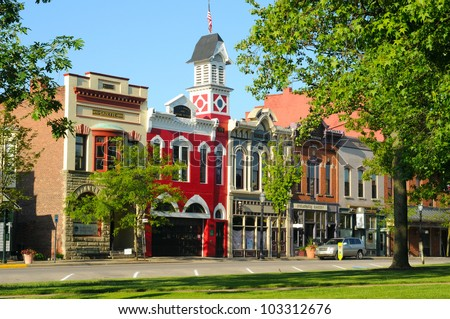 MEDINA, OH - MAY 19: East Washington Street in Medina, Ohio, on May 19, 2012, features a historic town hall and firehouse (bright red building) more than 130 years old. - stock photo