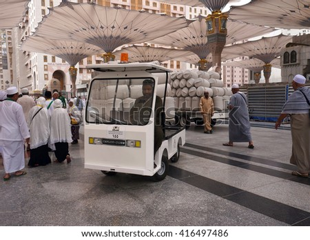 MEDINA, SAUDI ARABIA-CIRCA MAY 2015: unidentified worker drive a vehicle to bring a zam zam water barrel in Nabawi Mosque on MAY, 2015 in Medina, Saudi Arabia . - stock photo