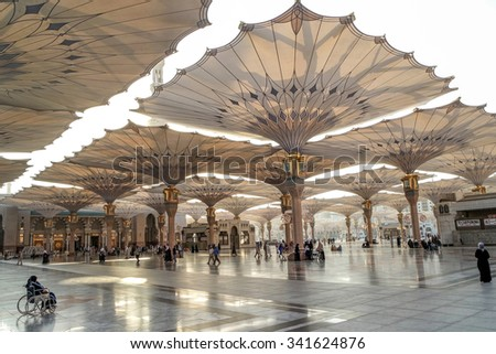 MEDINA, SAUDI ARABIA-JAN 30: Muslims from different countries in the courtyard of the mosque of the Prophet on January 30, 2015 in Medina, KSA. The Nabawi mosque is the second holiest mosque in Islam.
