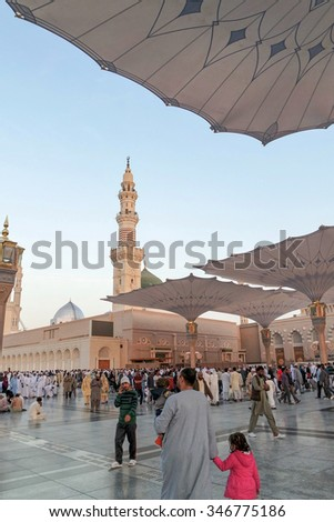 MEDINA, SAUDI ARABIA (KSA) - JAN 30: Muslims from different countries in the courtyard of the mosque of the Prophet on January 30, 2015 in Medina, KSA. The mosque is the second holiest mosque in Islam - stock photo