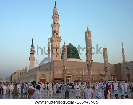 MEDINA, SAUDI ARABIA (KSA) - SEPTEMBER 7: Muslims get ready to pray inside Nabawi Mosque September 7, 2010 in Medina, KSA. Muslims gathered for prayer around the Prophet's mosque - stock photo