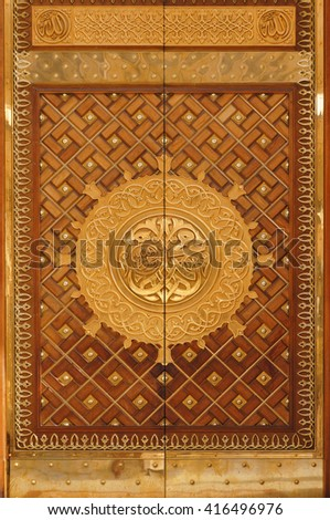 MEDINA, SAUDI ARABIA -MAY 2015 : Close up view of King Fahd Door of Masjid Nabawi on May, 2015 in Medina, Saudi Arabia. Nabawi Mosque is the second holiest mosque in Islam - stock photo