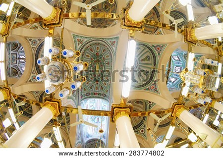 MEDINA, SAUDI ARABIA -MAY 2015 : Interior of Masjid Nabawi on May, 2015 in Medina, Saudi Arabia. Nabawi Mosque is the second holiest mosque in Islam and here is Prophet Muhammad is laid to rest - stock photo