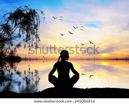 meditating on the lake, - stock photo