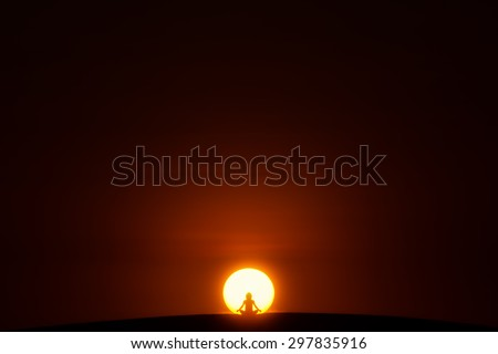 Meditation. A person is sitting in the Lotus pose in center of the Sun.  - stock photo