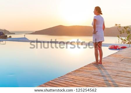 Meditation at sunrise over idyllic coast of Greece - stock photo