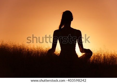 Meditation in a peaceful setting.  - stock photo
