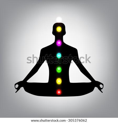 Meditation man silhouette with chakras - stock photo