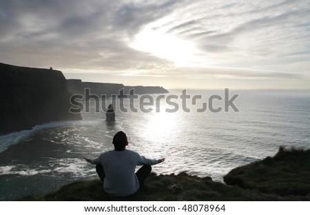 Meditation on the cliffs - stock photo