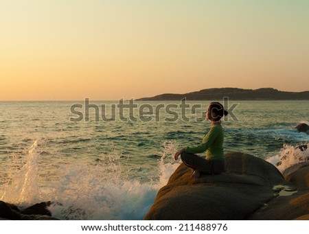 Meditation on the rock - stock photo